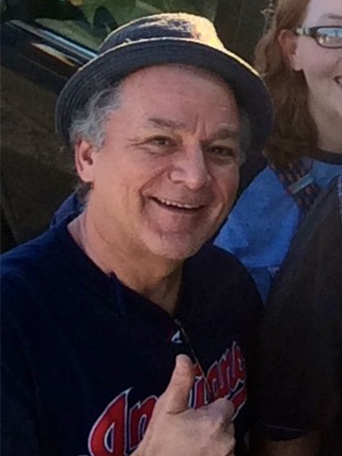 "img src=""Mark-E.-Caldwell-2.png"" alt=""man with hat and smile gives thumbs up to audience"">"